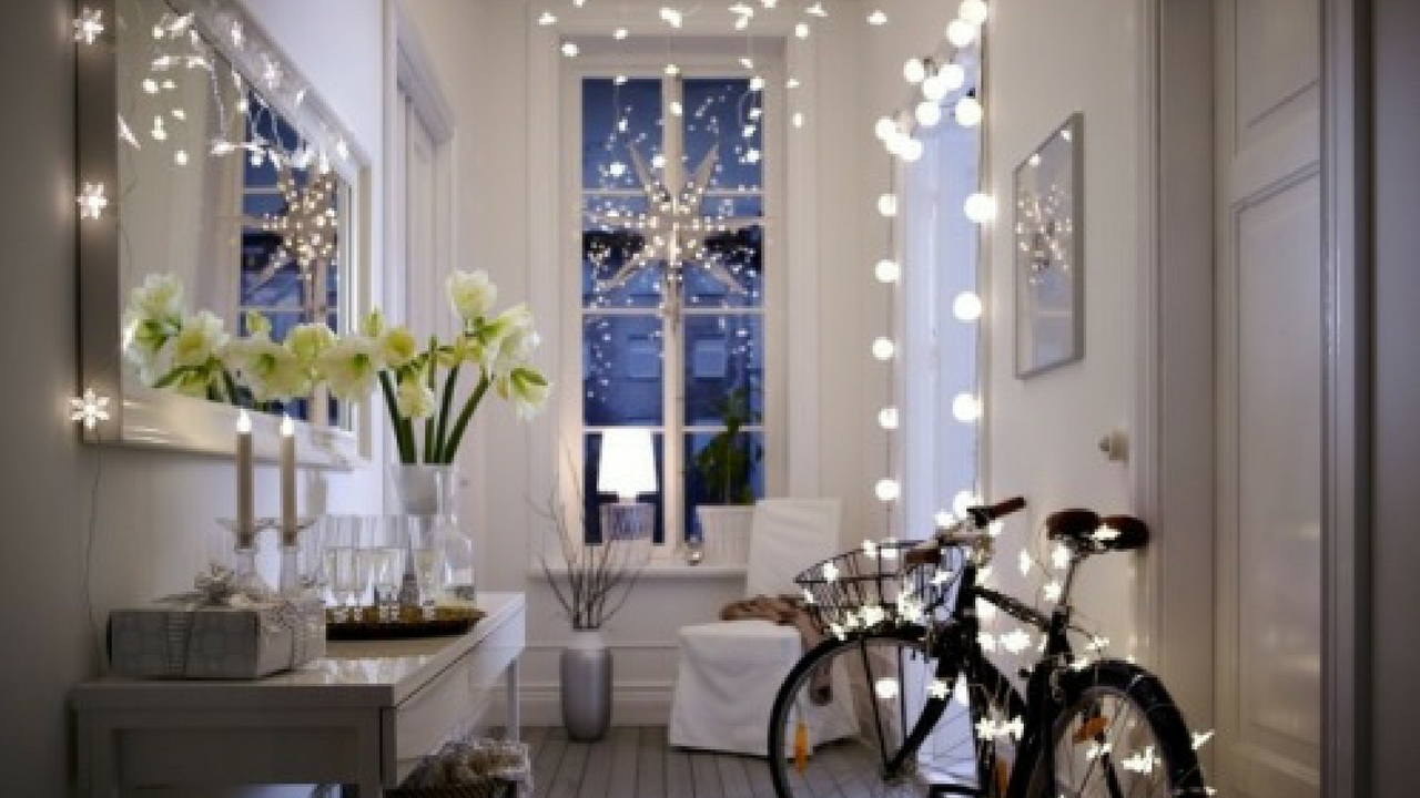 christmas fairy lights in a white open space home