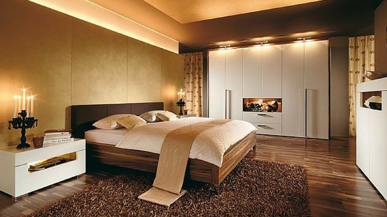 dark colours a stylish brown coloured bedroom with ceiling lighting