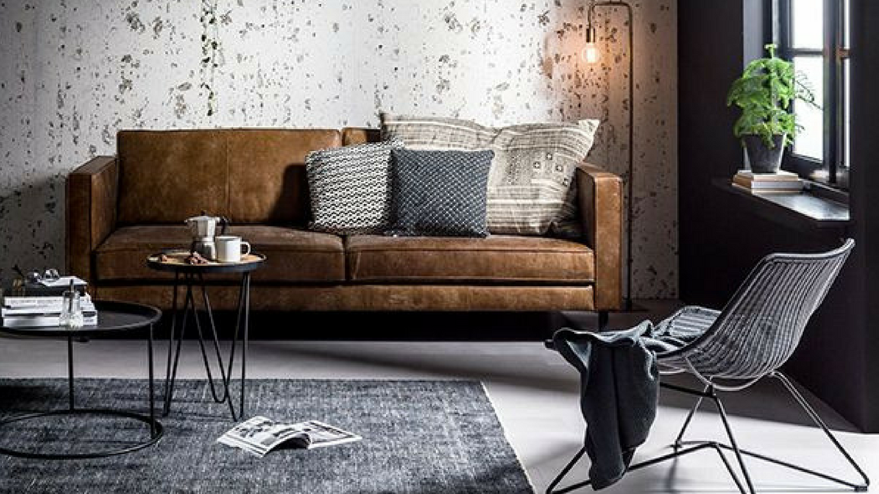 dark colours industrial inspired living room with dark grey furniture accents