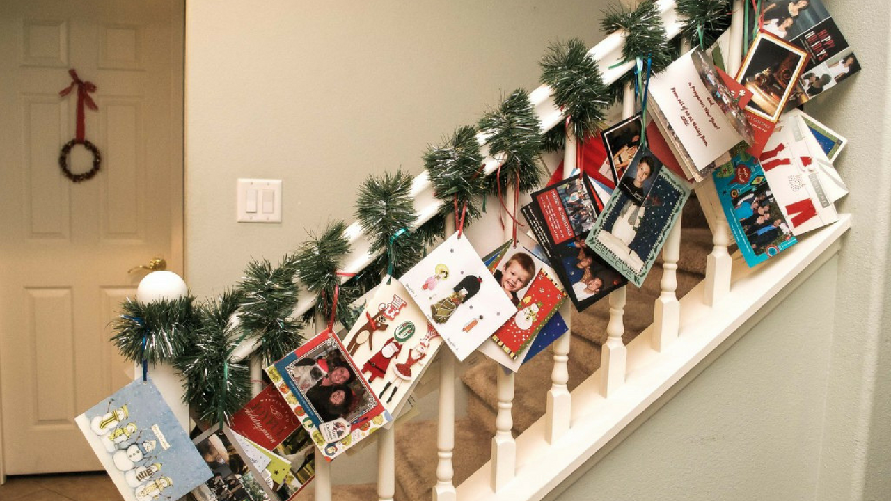 hanging christmas cards on a stairwell