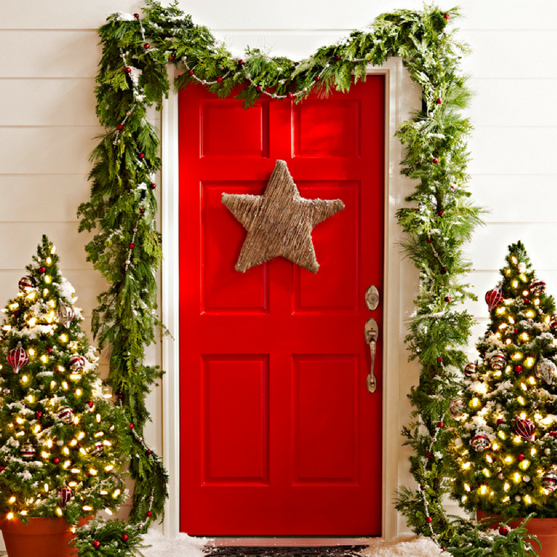 Christmas Door Star Decoration on a red door with a garland