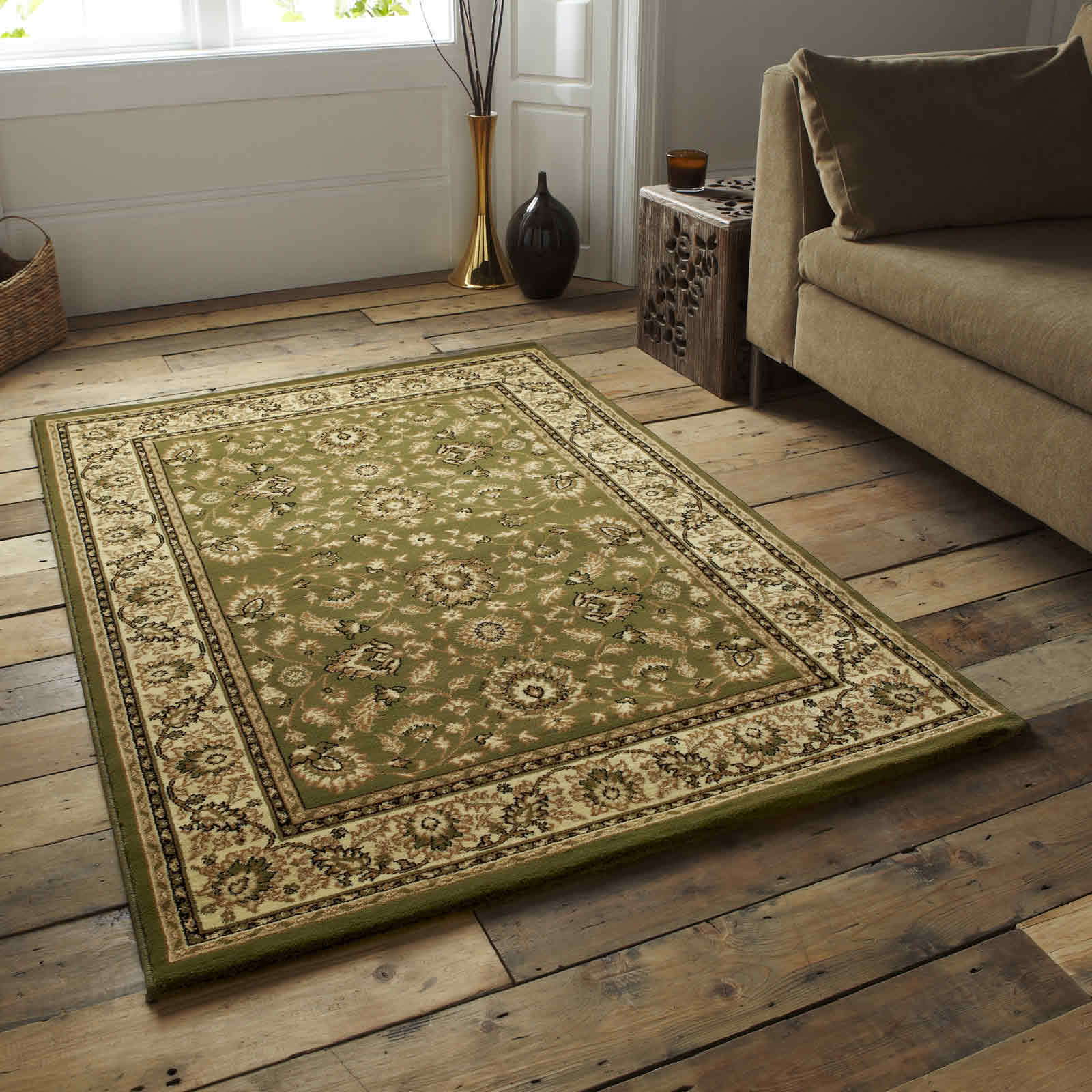 traditional green rug on matte wooden living room floor