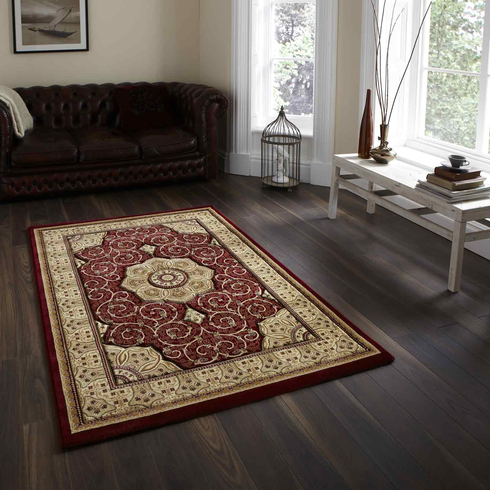 red and gold kilim rug on dark wood floor in lving room with a leather couch
