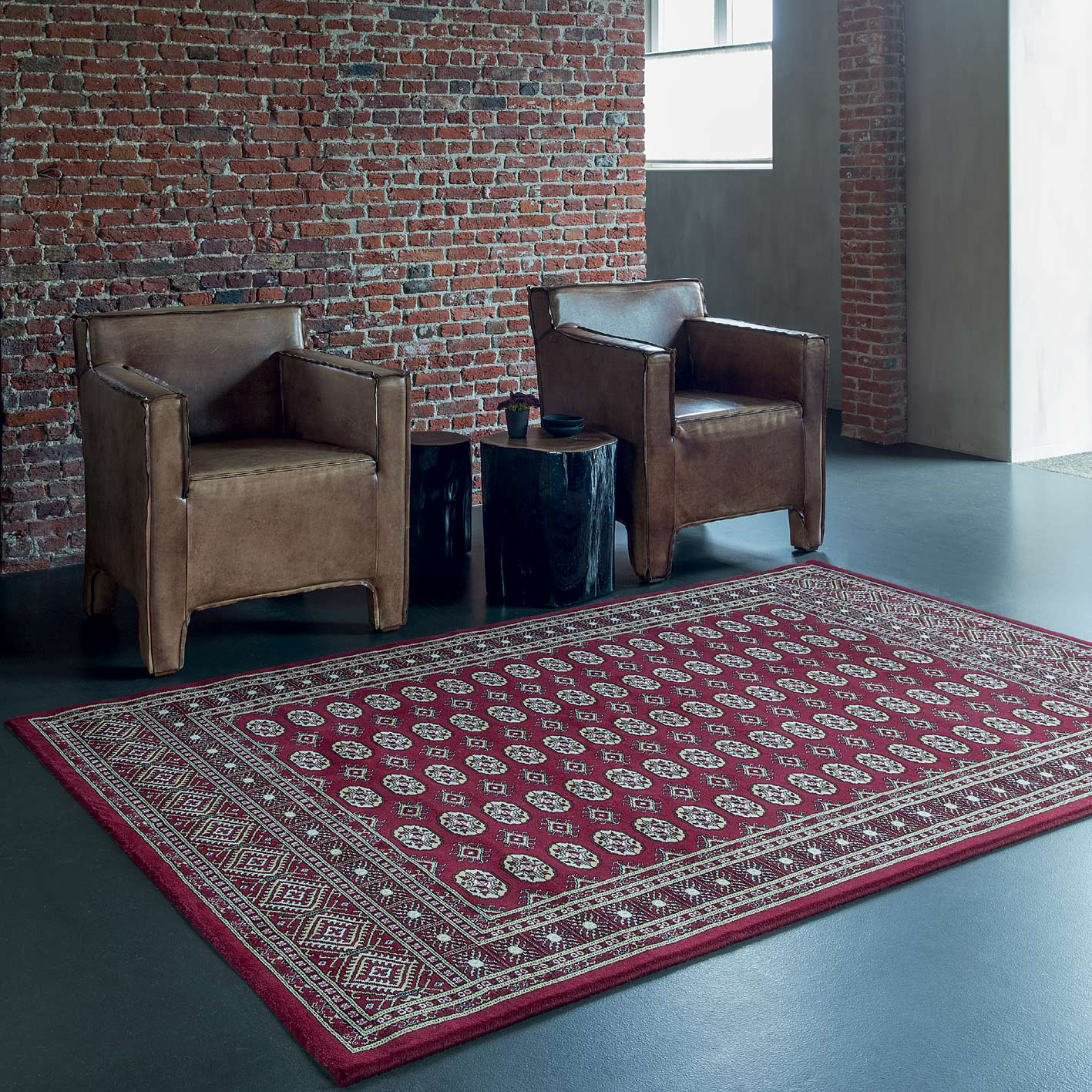 red noble art traditional rug in industrial styled interior with 2 chairs and a table