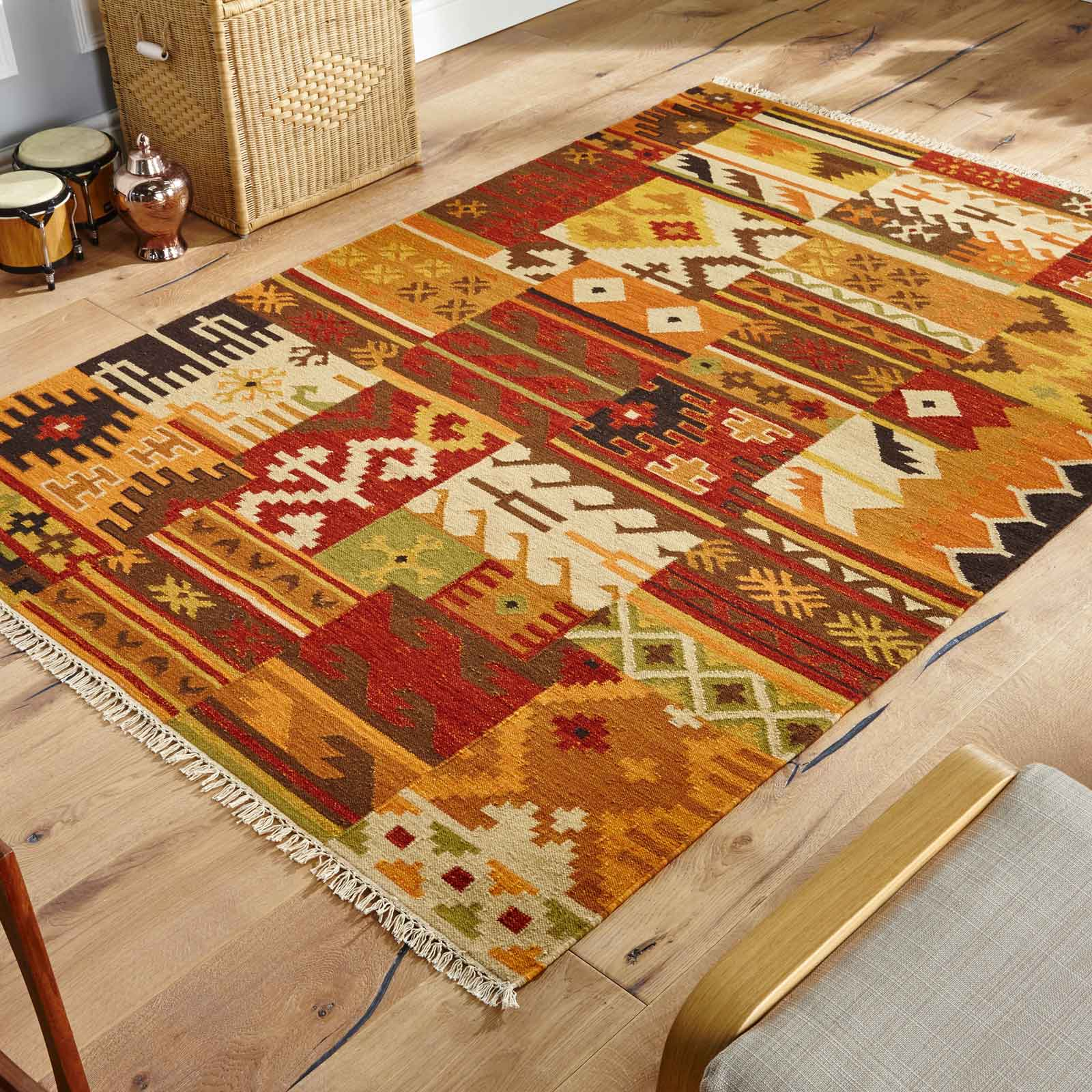 kilim rug on wooden flooring with chair on frame of image the rug seller