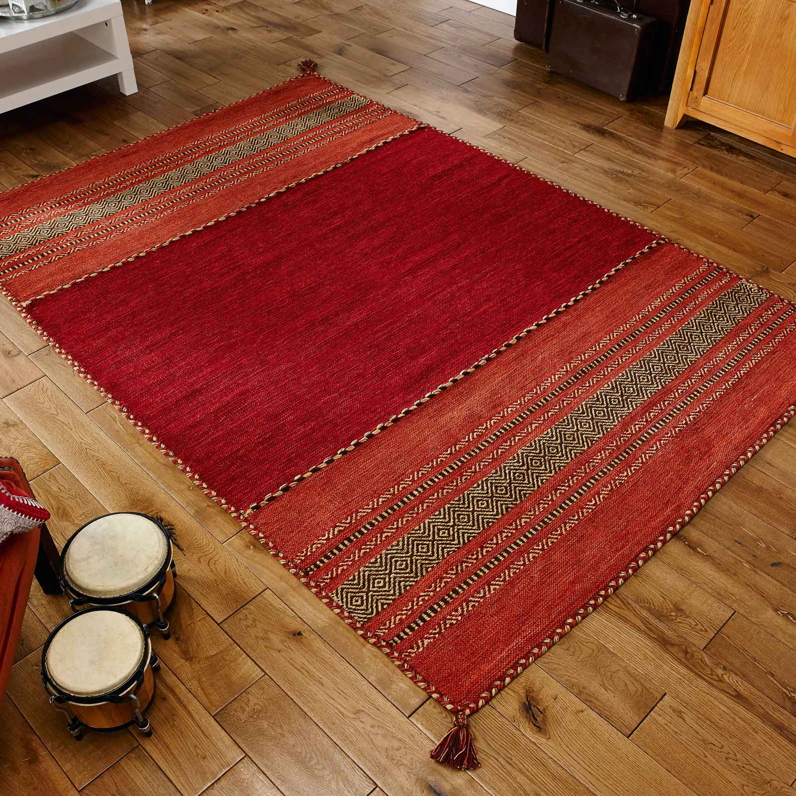 red kilim rug on wooden floor