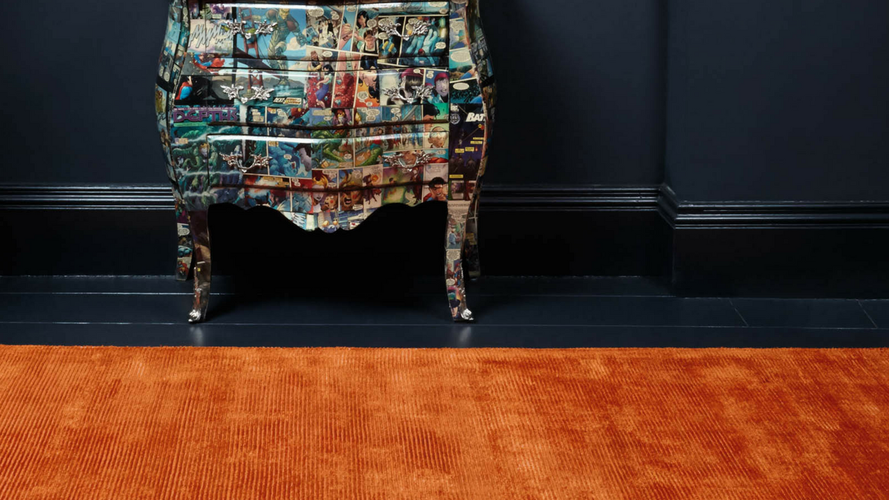 orange reko rug in a dark room