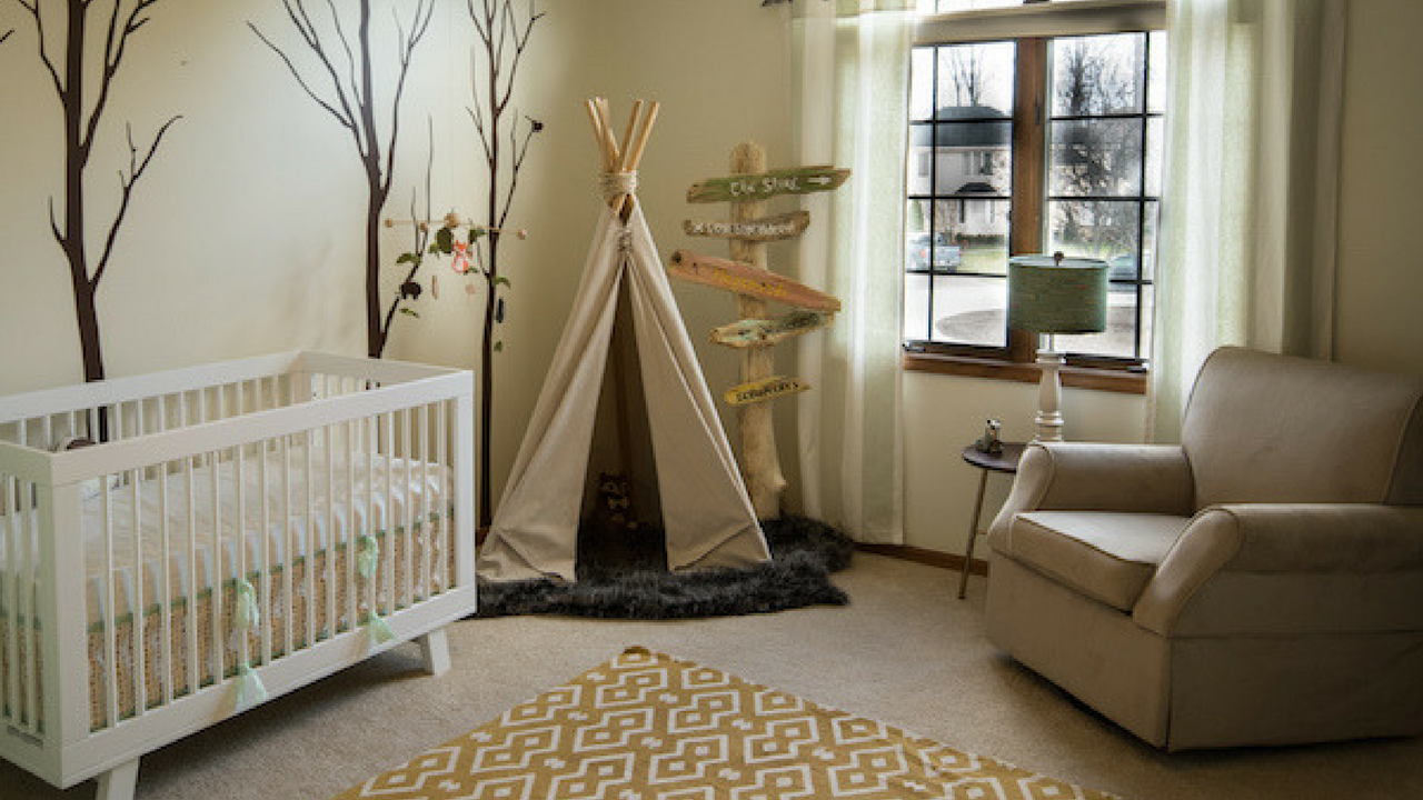 woodland theme decor in a large beige nursery