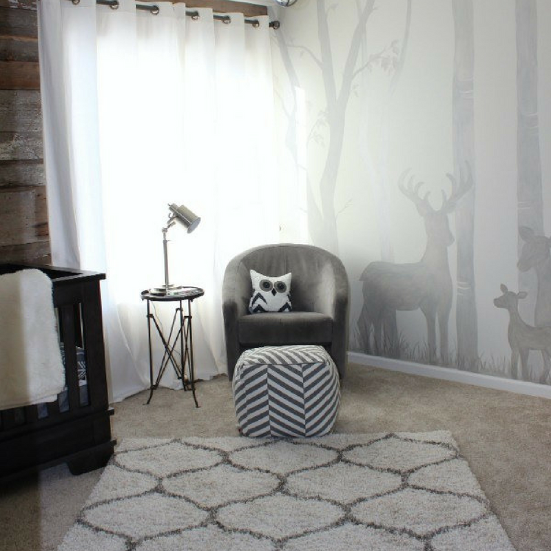 woodland theme wall decor in a large grey room