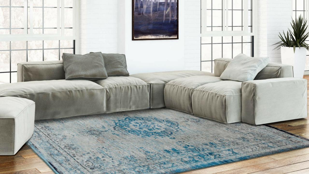 blue fading world rug by Louis De Poortere