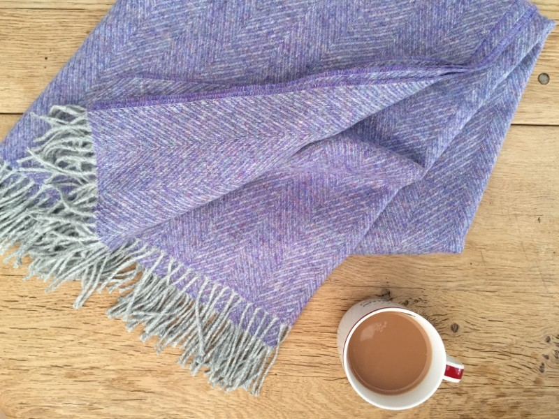 gorgeous blanket next to a coffee