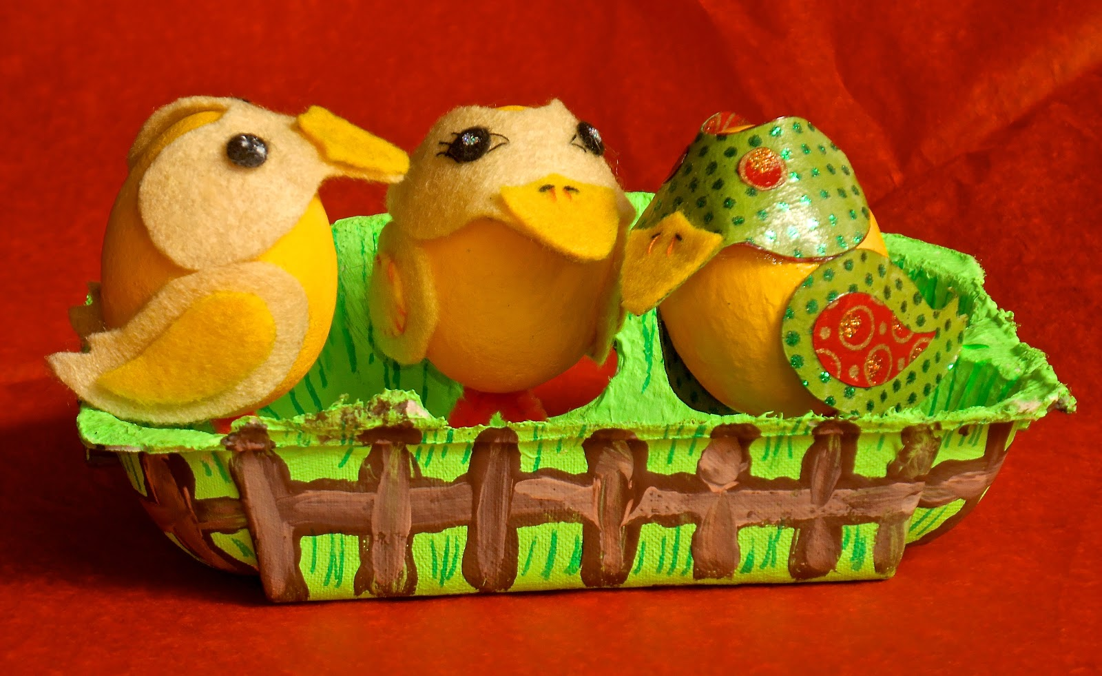 hand decorated eggbox with decorated eggs inside