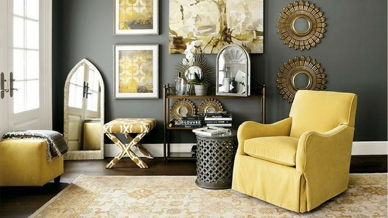 Yellow living room with a large sofa and accents