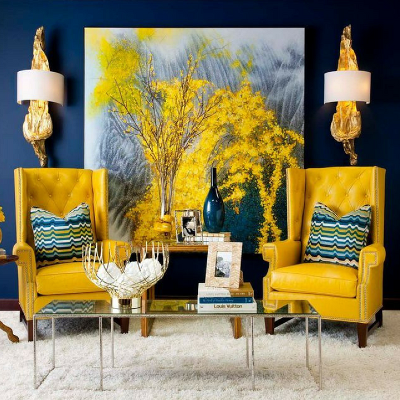 Sophisticated style in a large living room with yellow sofa chairs