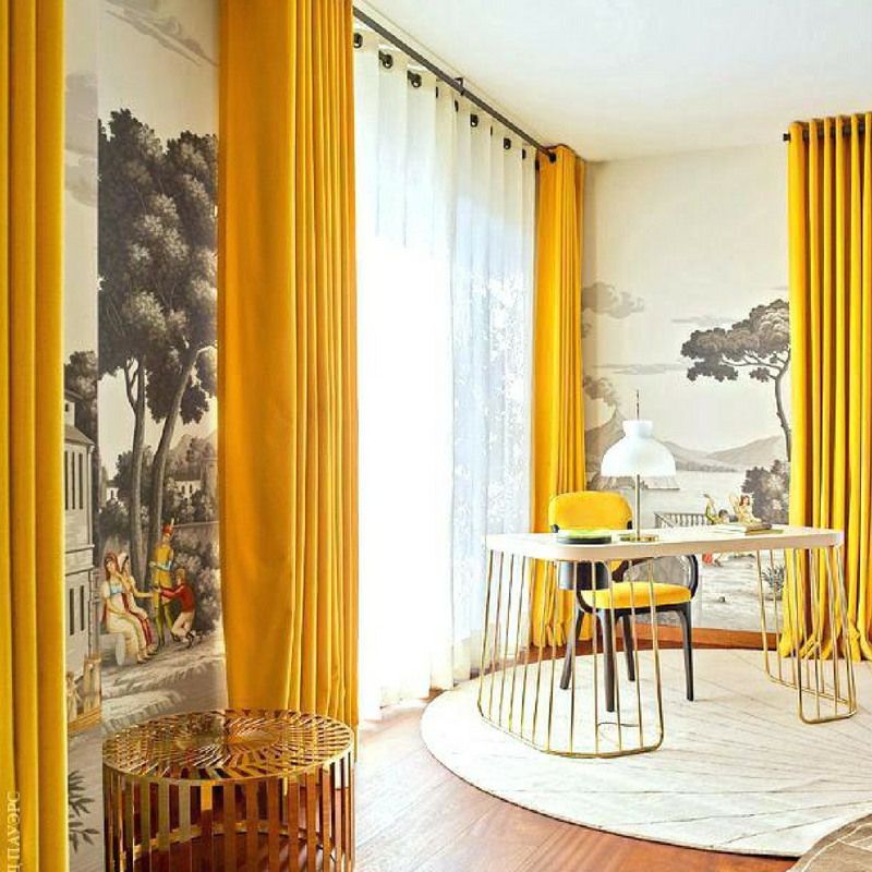 Mustard yellow long curtains in a large dining room