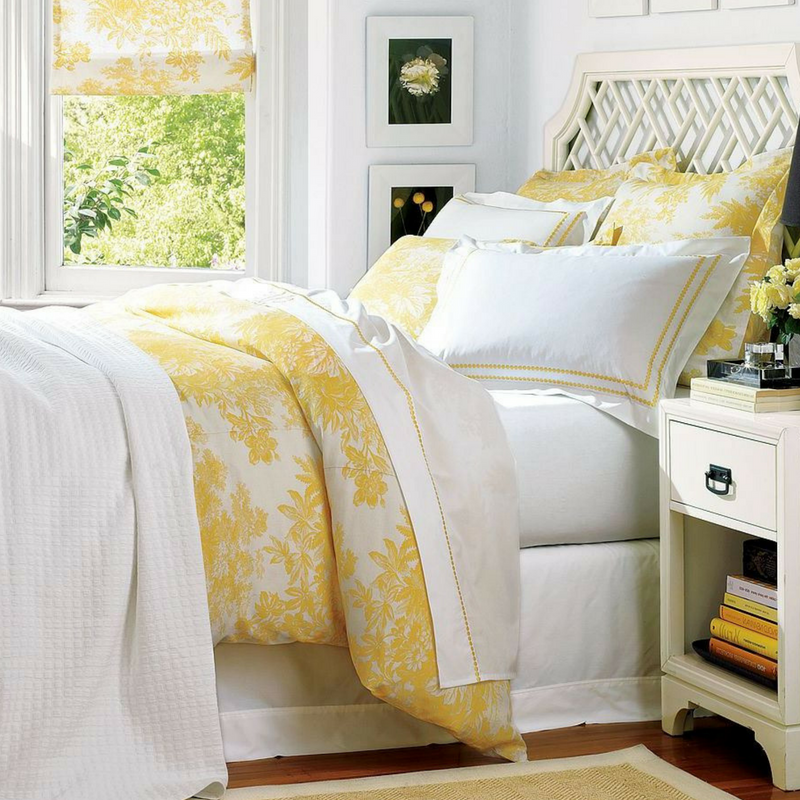 Yellow and white sophisticated and stylish bedroom decor