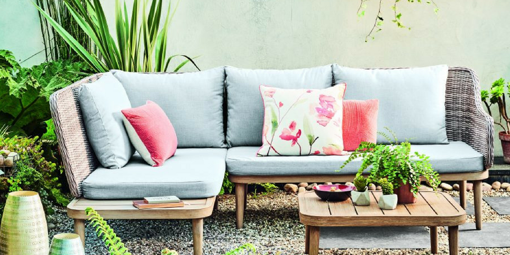 Outdoor Space with Greenery and Stylish Floral Cushions