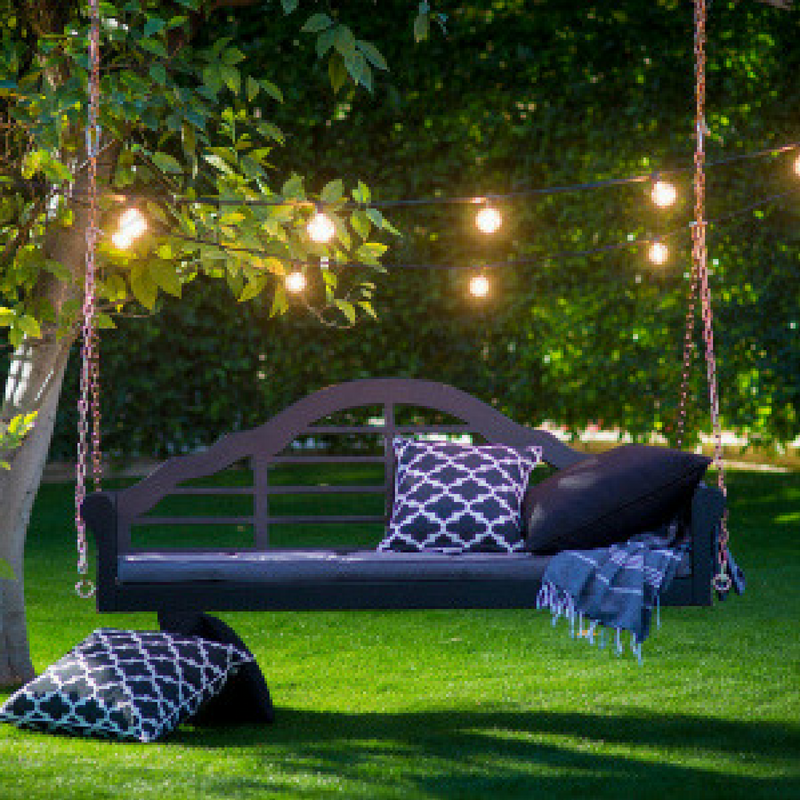Outdoor Lighting behind a sofa swing