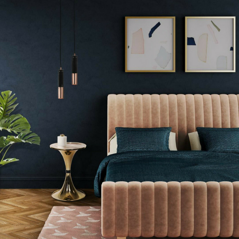 Interior Design Trends Velvet Bed in a dark room