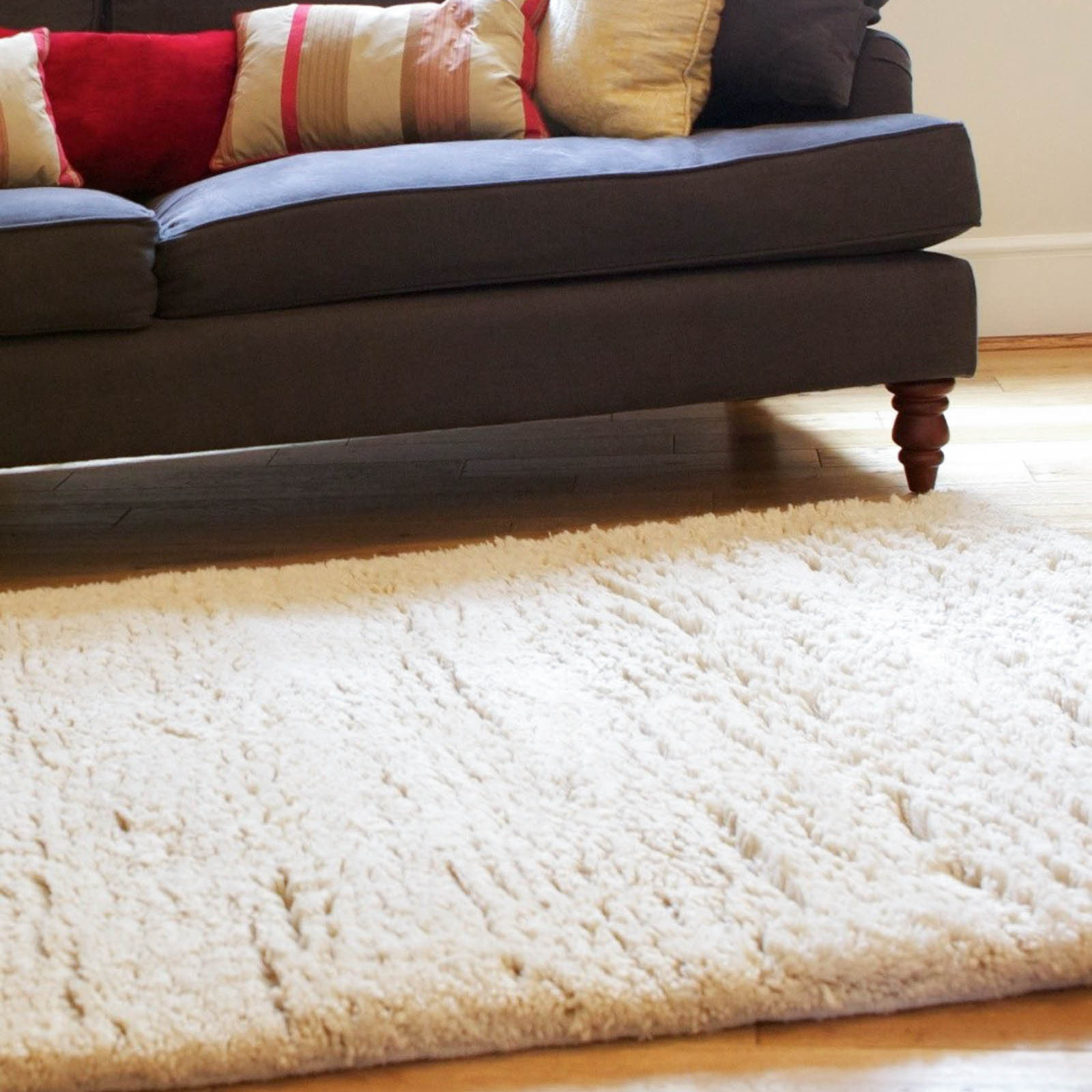 goochy cream shaggy wool rugs - free uk delivery - the rug seller