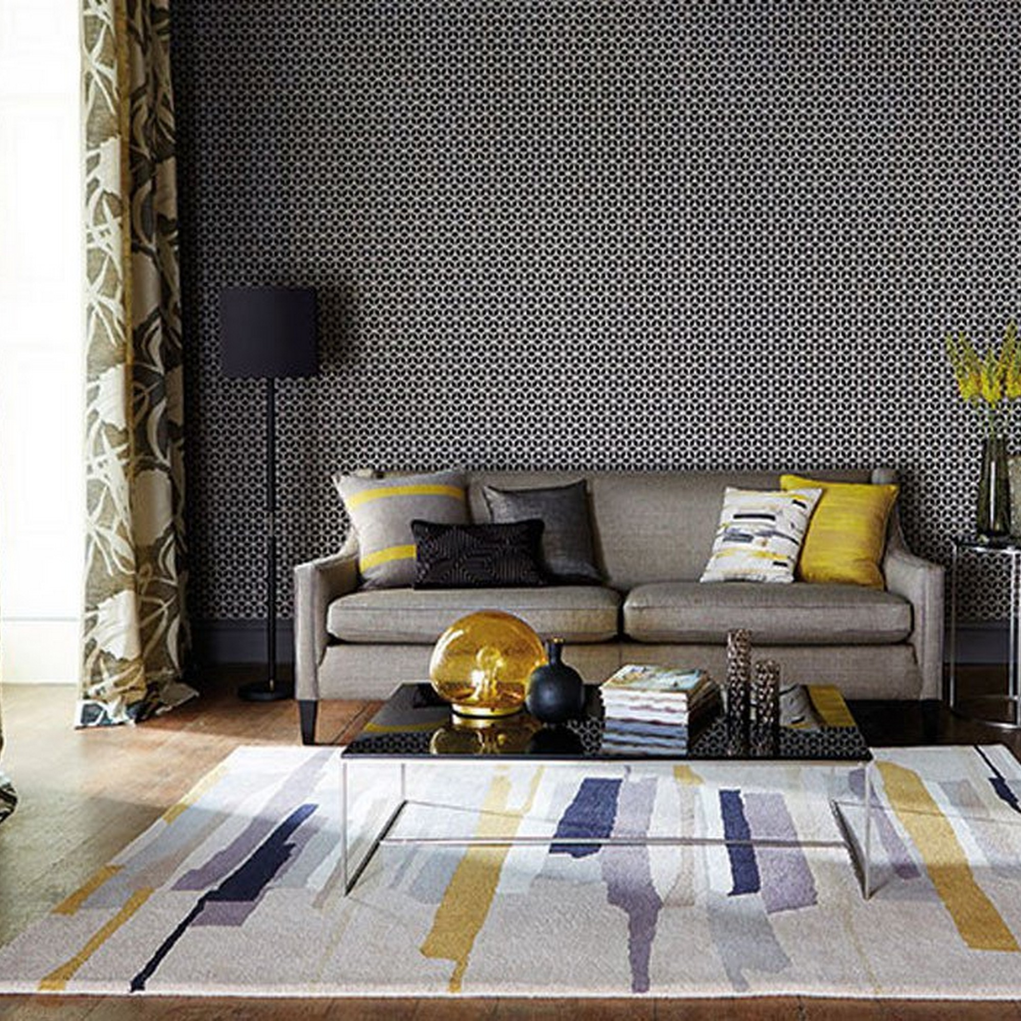 A Saffron And Grey Printed Living Room Rug Next To Sofa With Accented Coloured